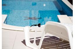 sunbathing by the pool in croatia